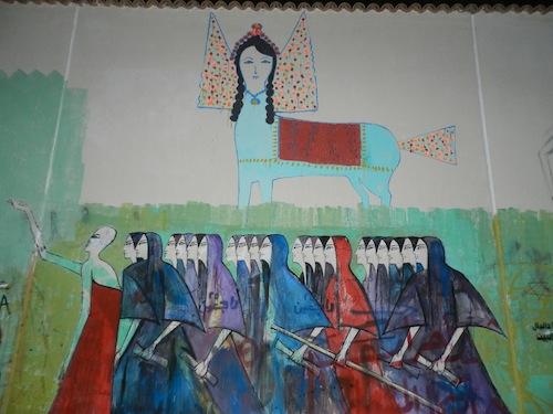 Une peinture inspirée de l'art populaire égyptien. Le buraq (animal, à face humaine, qui transporta le Prophète d'abord vers Jérusalem, puis vers les cieux lors du isrâ' et du mi'râj) a été ajouté au dessin la veille du jour où cette photo a été prise. (3 mars 2012)